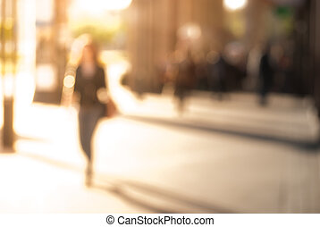 city commuters - People walking down the street in the...