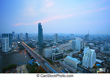 top view of bangkok skyscraper and traffic crossing...