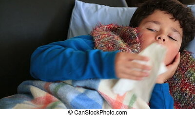 Sick, tired child lying and blowing nose - Young boy sick...