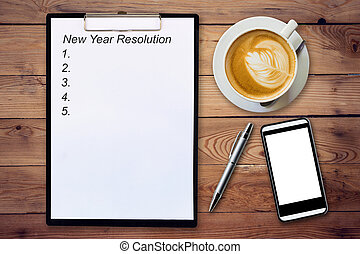 Business concept - Top view clipboard writing New Year...