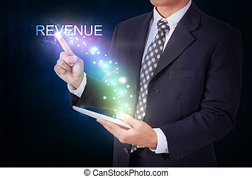 Businessman holding tablet with pressing revenue. internet...