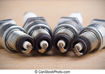 Spark plugs photo - Old spark plugs as spare part of car.