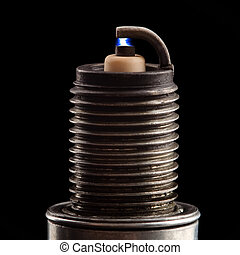 Spark plug photo - Old spark plug as spare part of car on...