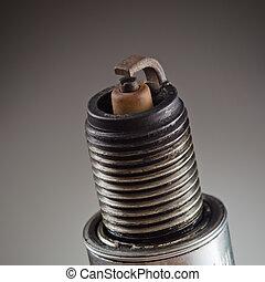 Spark plug photo - Old spark plug as spare part of car on...