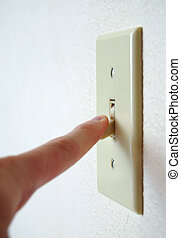 Light Switch Off - A single light switch on a white wall at...