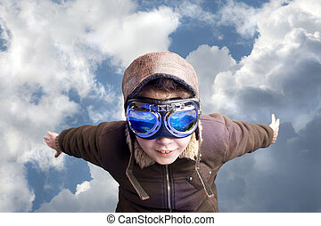 Boy flying, daydreaming he?s a pilot