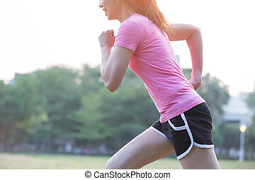 woman running with green background