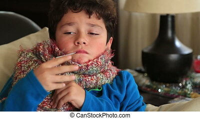 Portrait of a sick child feeling cold in winter