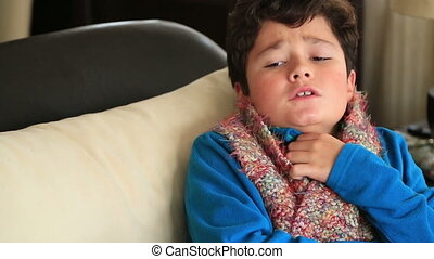 Portrait of a sick child feeling cold in winter - Sick young...