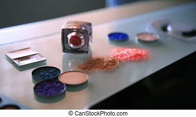 Cosmetic products with sequin stars arranged on a...