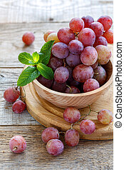 Pink grape with a waxy bloom. - Pink grape with waxy bloom...
