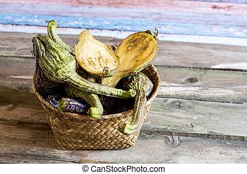 Healthy vegetables in wattled basket - Pile of organic ripe...