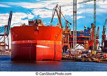 Ship in shipyard - A ship under repair at shipyard in...