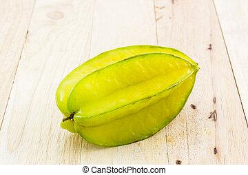 Star fruit or Carambola. - Star fruit or Carambola on wood...