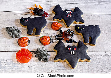 Bats and cats halloween cookies and fruit jelly - Top view...