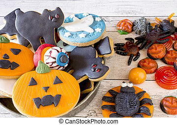 Halloween cookies in bowl with fruit jelly on table -...