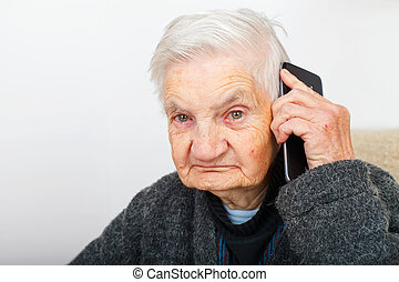 Timeless communication - Photo of a senior woman talking on...