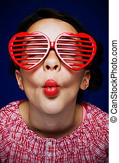 Gril with shutter shades - Young girl with heart shaped...