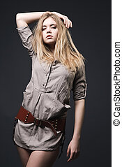 Beautiful blond fashion model with blowing hair