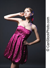 Beautiful young woman wearing pink dress