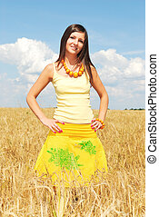 Girl in a yellow field of wheat