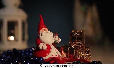 Santa Claus with gifts on a background of flashing lights.