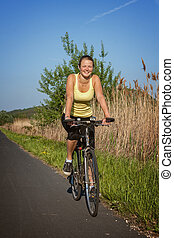 Happy young girl  with a bike