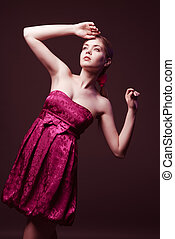 Attractive young woman wearing on pink dress
