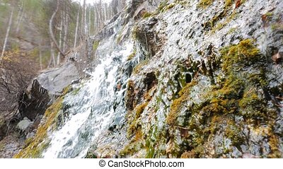 The waterfall in the rocks. Russia.