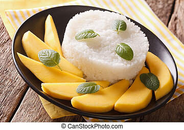 Glutinous rice with ripe mango close-up te on the table....