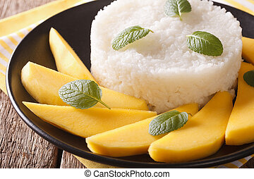 Thai style dessert, glutinous rice eat with mangoes closeup....