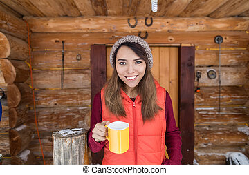 Young Asian Girl On Terrace Holding Cup Hot Coffee Tea...