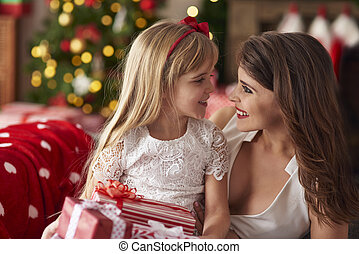 Mother and girl having good time together
