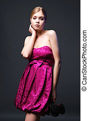 Lovely young woman wearing on pink dress