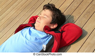 Child boy relaxing and dreaming at the outdoor - Portrait of...