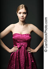 Attractive young woman wearing pink dress