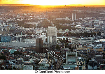 London Eye and Big Ben by the river Thames from above at...