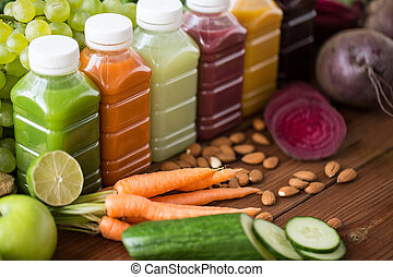 bottles with different fruit or vegetable juices - healthy...