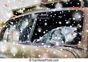 war truck with broken windshield glass over snow - wartime,...