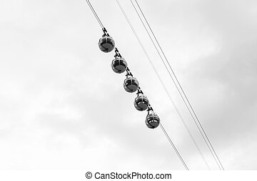transparent cable cars that links the Bastille with the city...