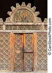 Door to Medersa Bou Inania - Beautiful artwork inside the...