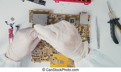 Inside view of hardware component. Repair of lmotherboards....