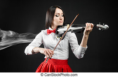 Attractiv ewoman playing the violin on a black background -...