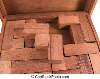Wooden block puzzle isolated on white