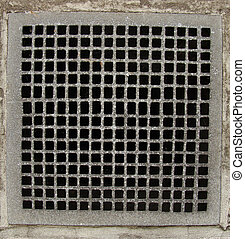 irregular metal grid from a ventilation shaft in a concrete...