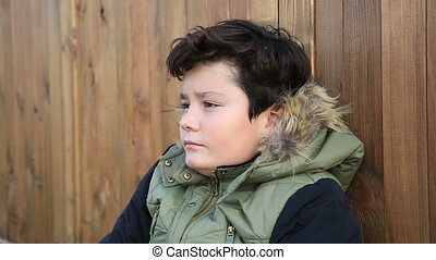 Winter portrait of cute boy in warm clothes smiling