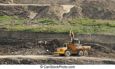 Excavator and truck working in quarry