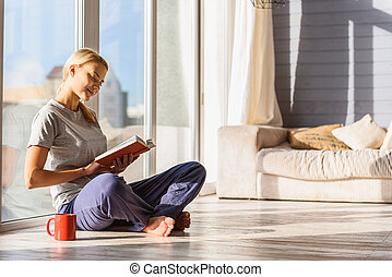 Carefree girl enjoying favorite literature - Peace and...