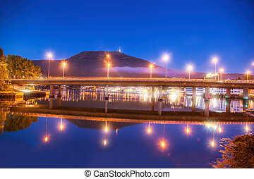 Bridge at night against Mount Ulriken in Bergen, Norway