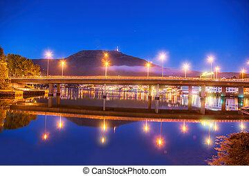 Bridge at night against Mount Ulriken in Bergen, Norway